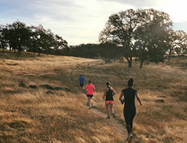 Trail runners at Deer Creek Hills Preserve